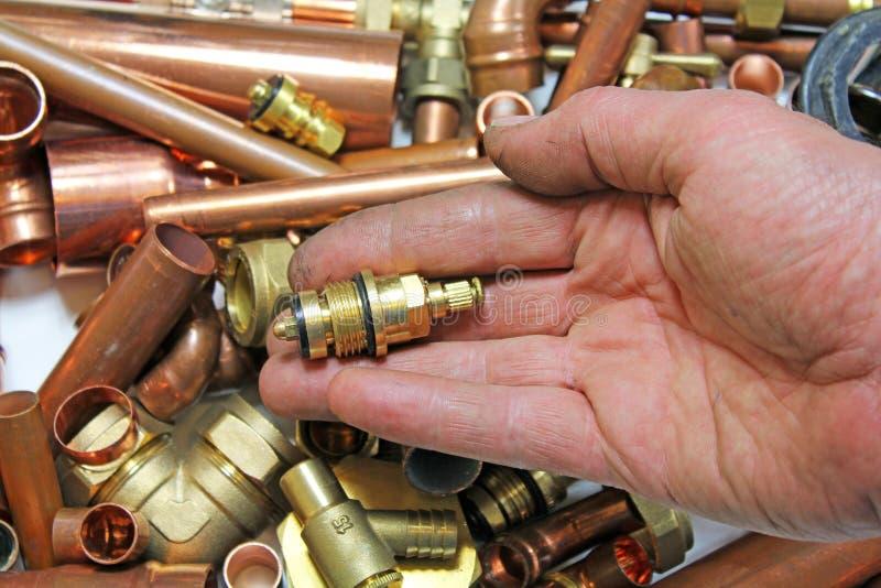 水管工配件和管子 免版税库存照片