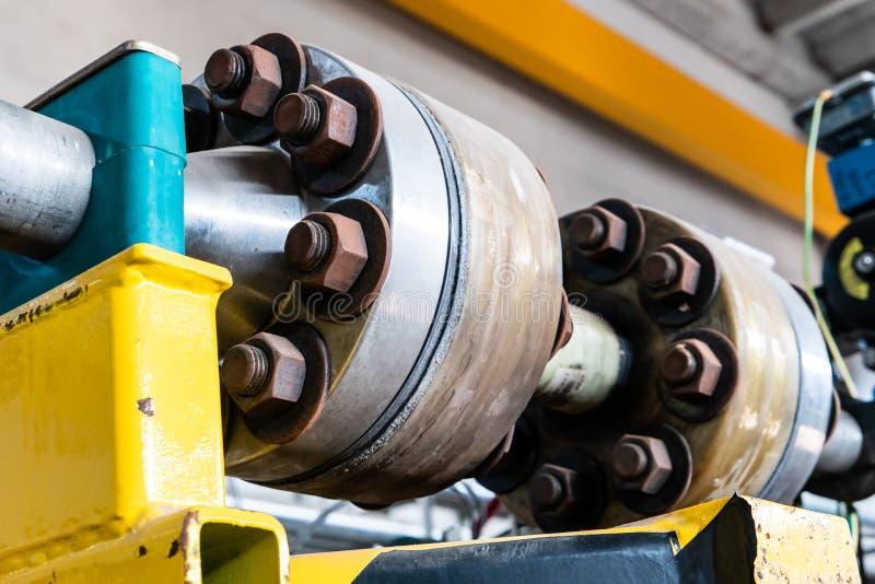 水管线上带有法兰和螺栓的玻璃钢接头 库存图片