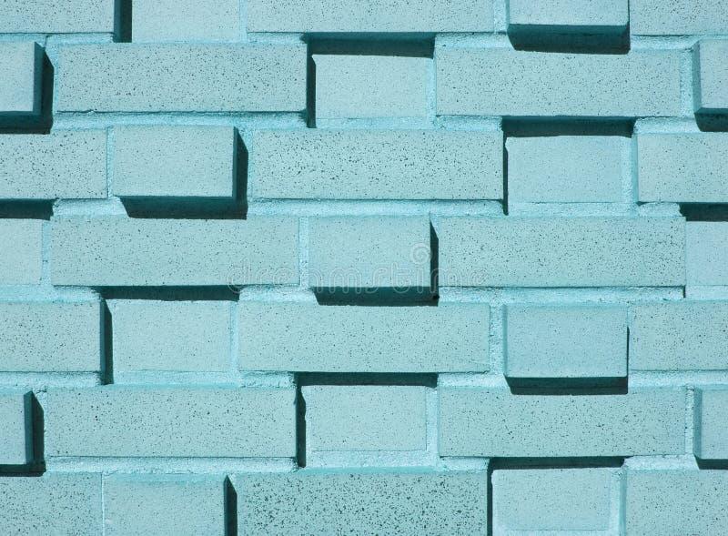 水色砖层状多墙壁 库存照片