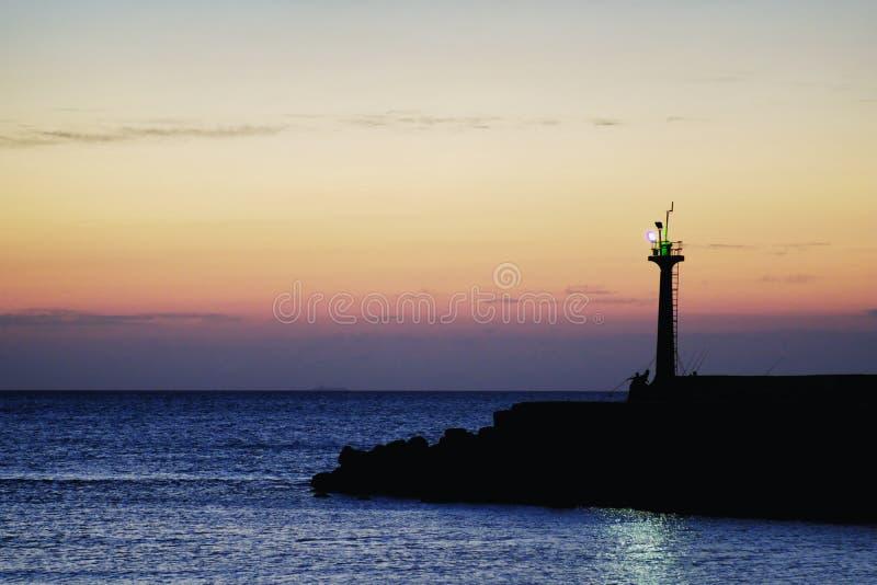 从永安鱼港口的日落风景在Xinwu区,桃园,台湾 免版税库存图片