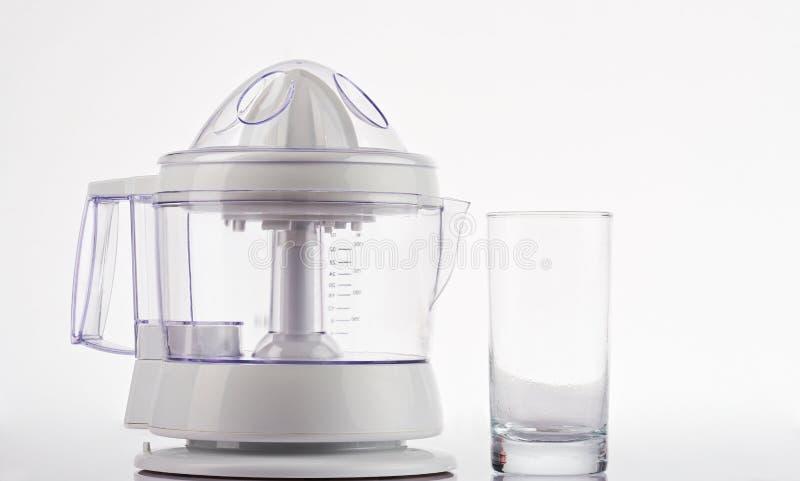 汁液制造商和空的玻璃 库存照片
