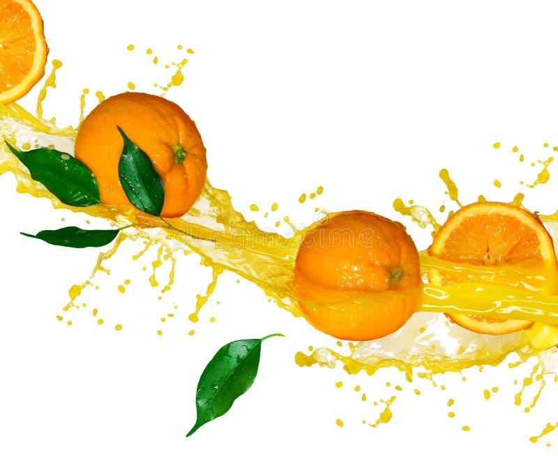 汁液桔子splashng 免版税库存照片