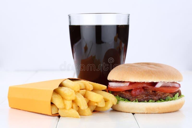 汉堡包和油炸物菜单膳食组合可乐喝不健康吃 图库摄影