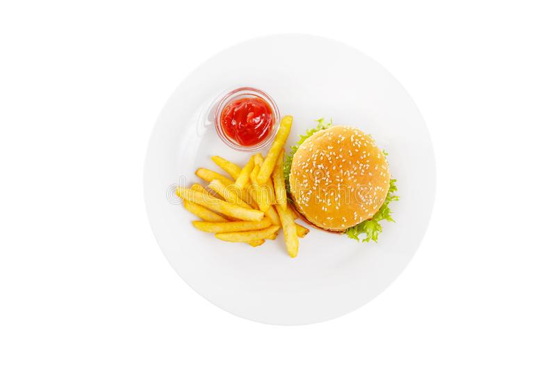 汉堡和炸薯条在板材被隔绝的白色 免版税库存照片