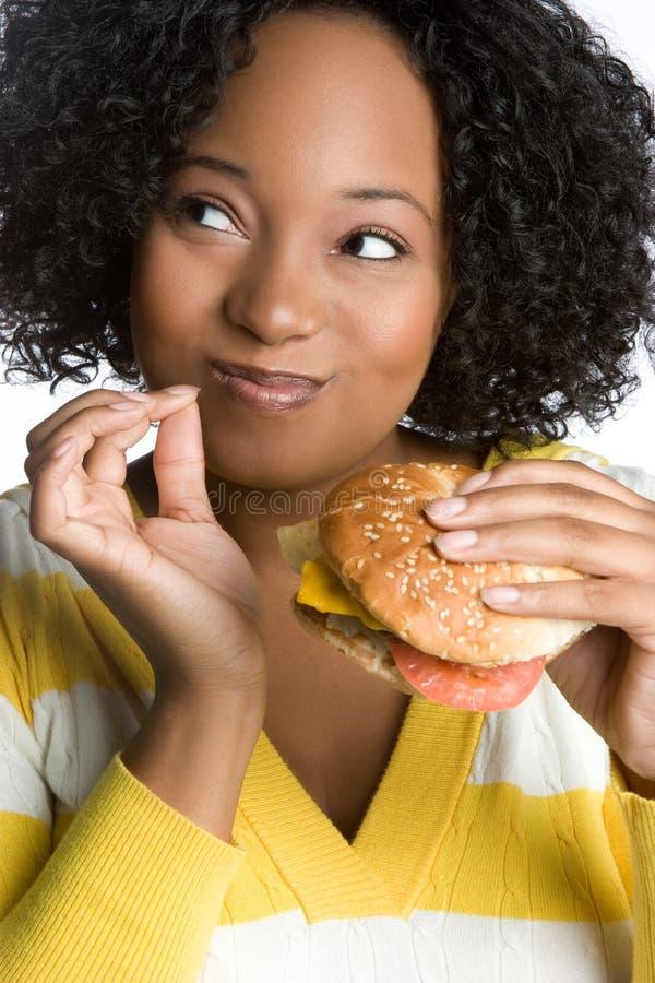 汉堡愉快的妇女 免版税库存照片