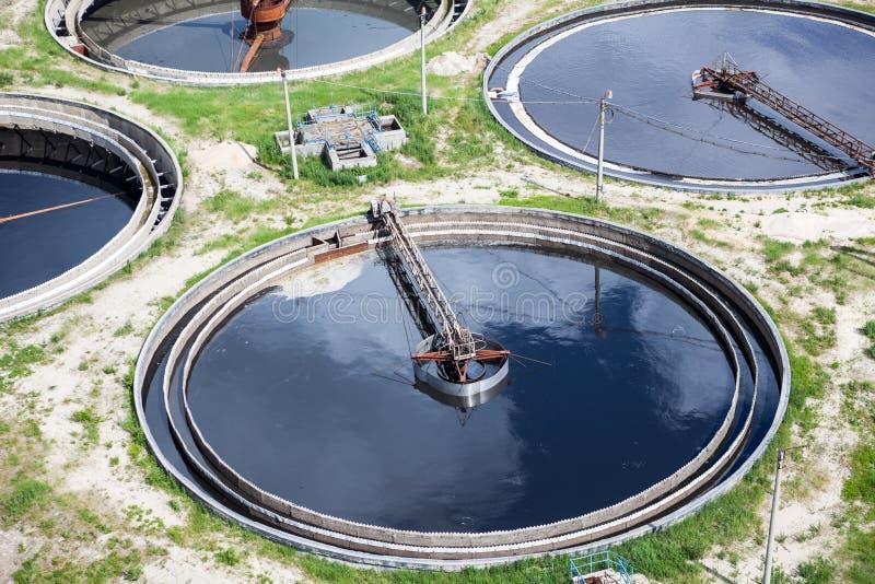 污水回收的四个圆的充分的水移居者 库存照片