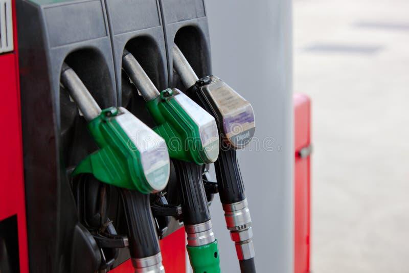汽油由喷嘴喷射加油泵岗位 免版税库存图片