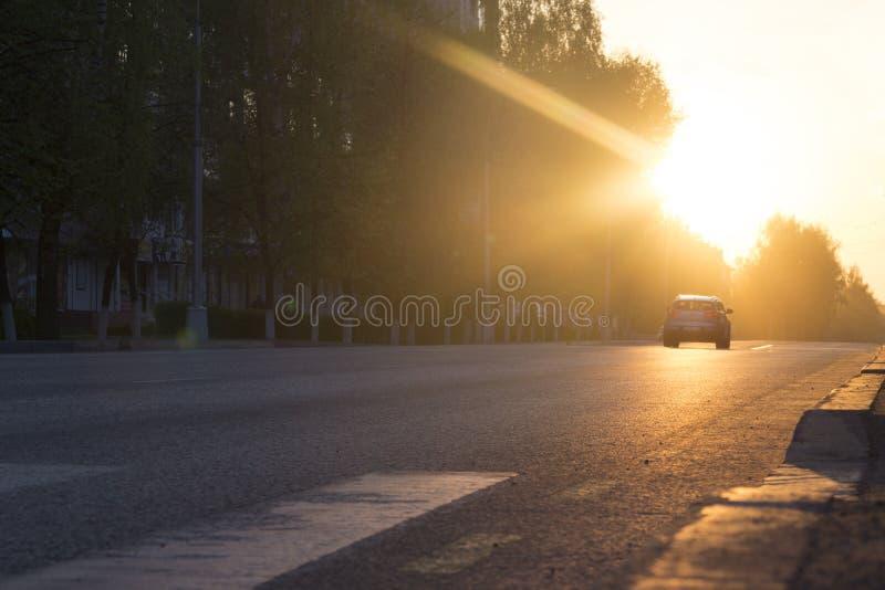 汽车例证日落向量 免版税库存照片