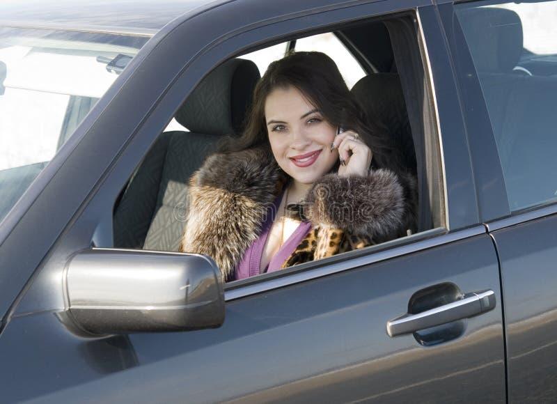 汽车妇女 库存图片