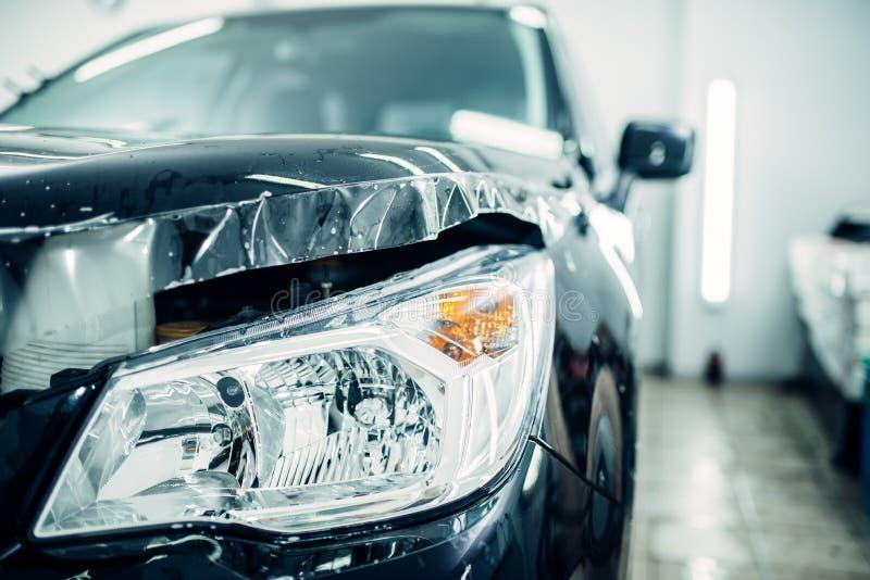 汽车敞篷在油漆保护影片特写镜头wraped 免版税库存图片