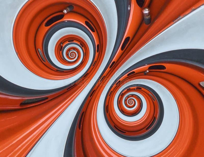 汽车汽车轮子外缘轮胎双螺旋摘要分数维背景 橙色轮子外缘螺旋作用样式摘要backgroun 库存图片