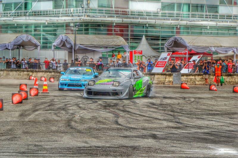 汽车汽车driffting的片刻的事件 免版税图库摄影