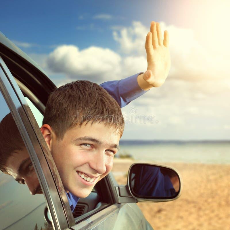汽车的少年 免版税图库摄影