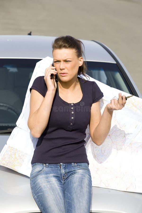 汽车的愉快的妇女 免版税库存照片