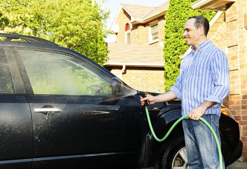 汽车车道人洗涤物 免版税图库摄影