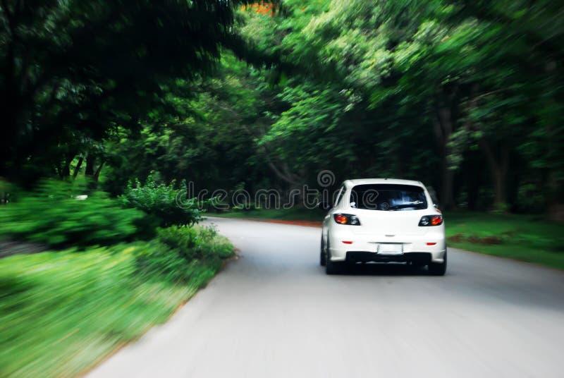 汽车驱动器以下所说速度白色 免版税库存照片