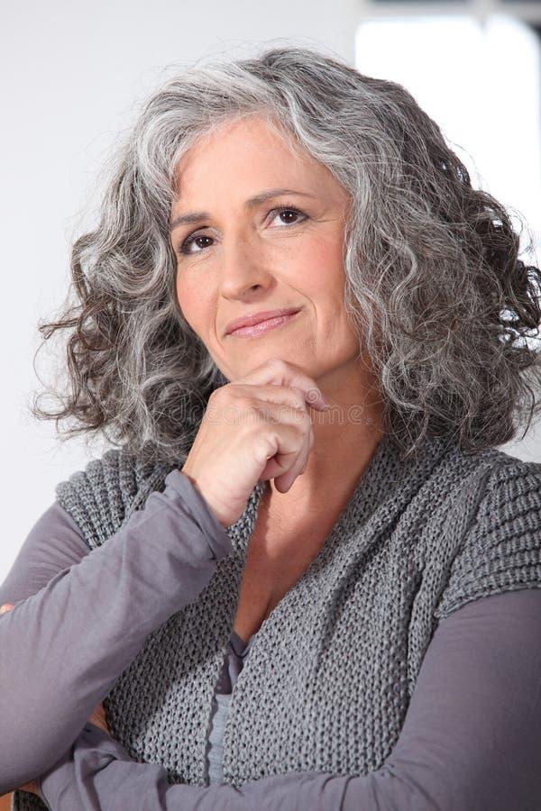 沉思中年妇女 库存照片