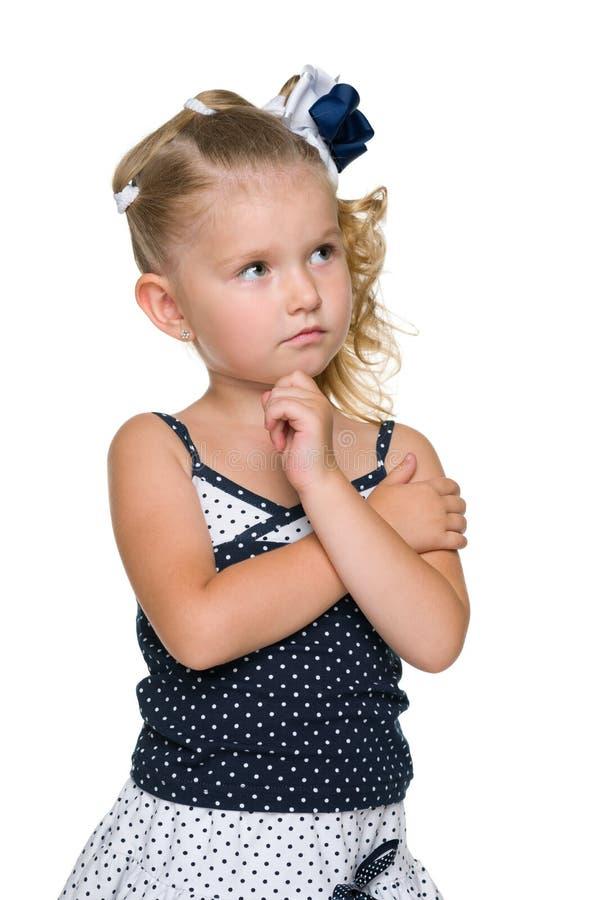 沉思白肤金发的小女孩 图库摄影