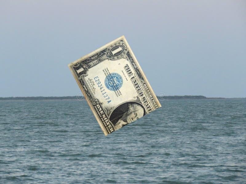 沉没于世界市场海的美元  免版税库存照片