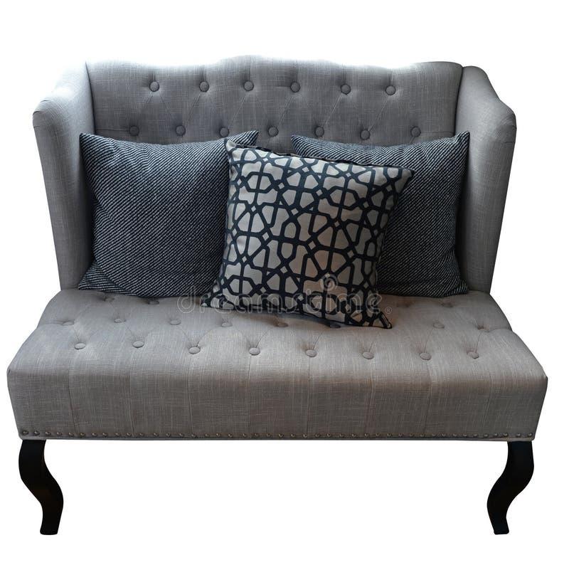 沙发投入了白色被隔绝的背景,包括的截去的部分 库存图片