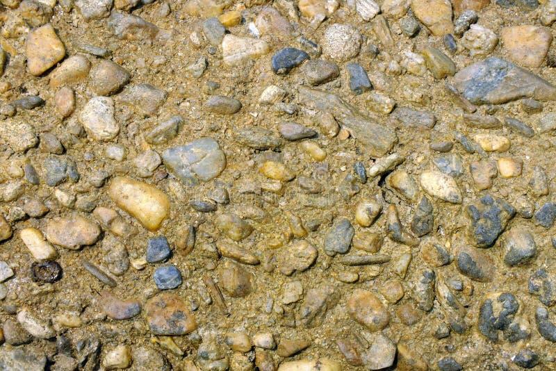 沙子和石头的表面 免版税库存图片