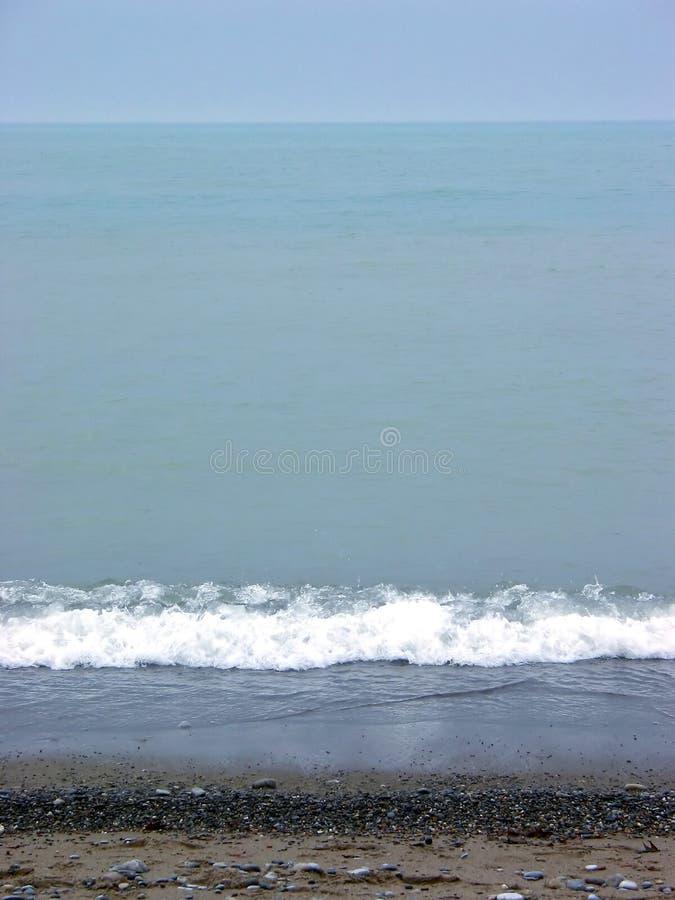 沙子海运天空 免版税库存照片