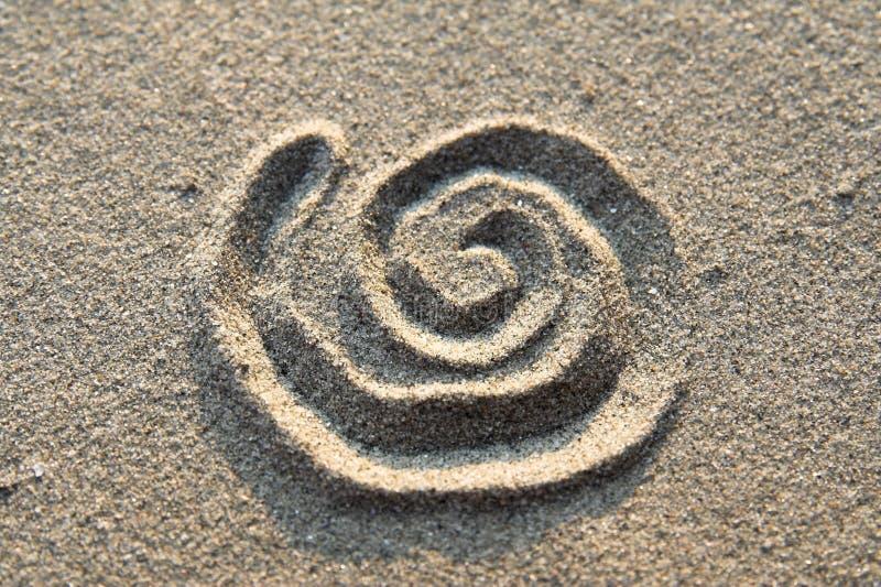 沙子符号螺旋 免版税库存照片