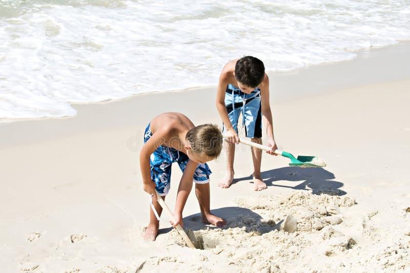 沙子铲起 免版税库存照片