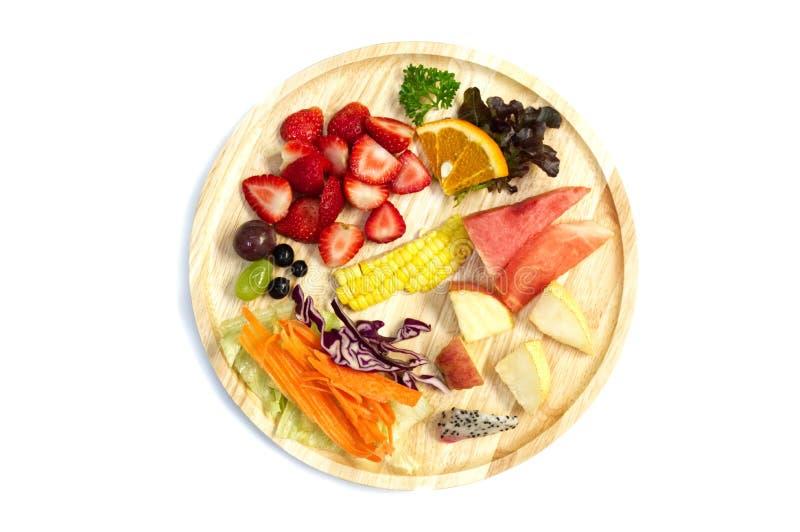 沙拉用混杂的水果和蔬菜在木板材 库存照片