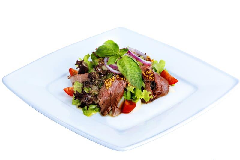 沙拉用煮沸的猪肉,西红柿,芥末 免版税库存照片