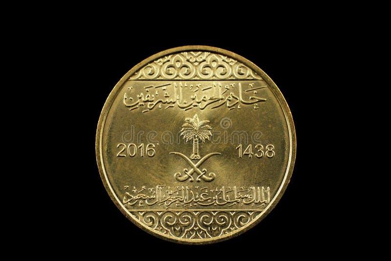 沙特阿拉伯在黑背景隔绝的金币 图库摄影