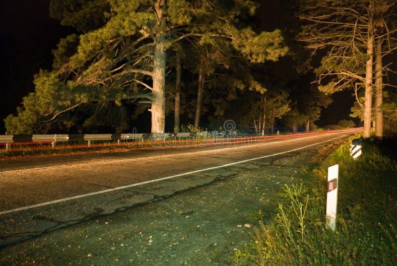 沥青晚上路 免版税库存图片