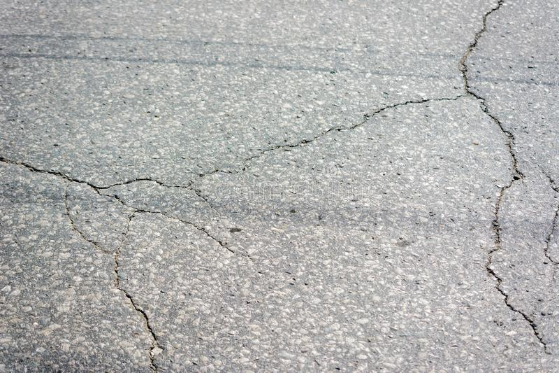 沥青纹理 破裂的柏油路表面纹理 库存图片