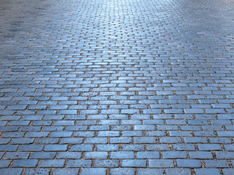 沥青背景路石头适当的阳光纹理 库存照片