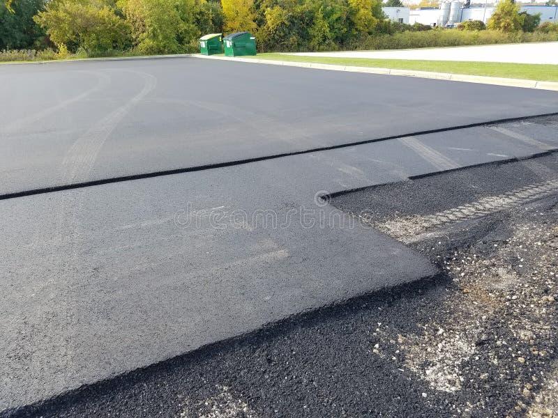 沥青车道,停车场修理 库存照片