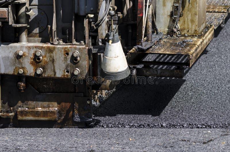 沥青铺的机器 免版税库存图片