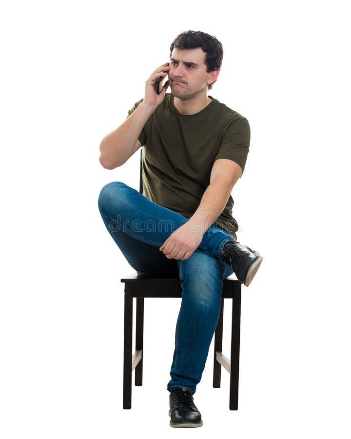 沮丧人电话谈话 库存照片
