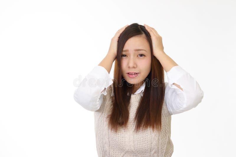 沮丧的亚裔妇女 免版税库存照片