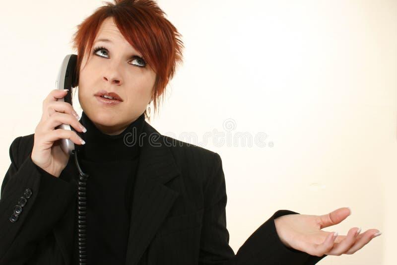 沮丧的电话妇女 库存图片