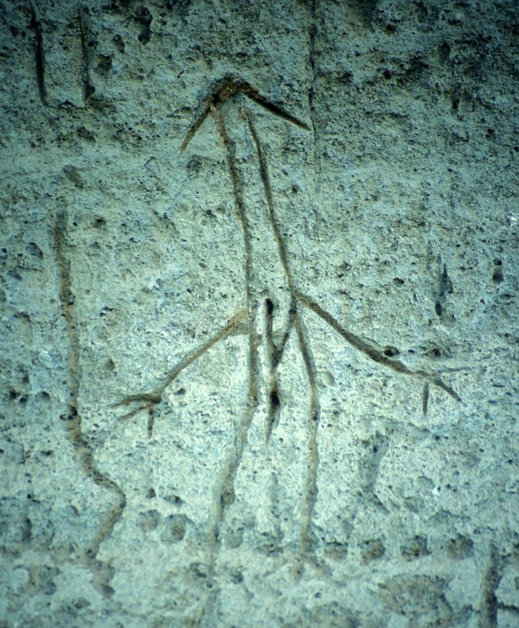 河床熔岩人刻在岩石上的文字棍子 免版税库存图片