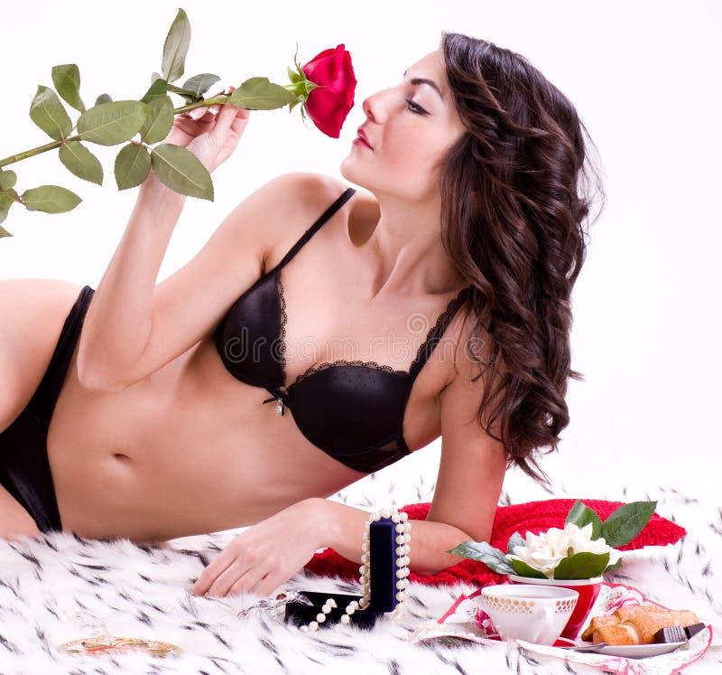 河床玫瑰色妇女 图库摄影