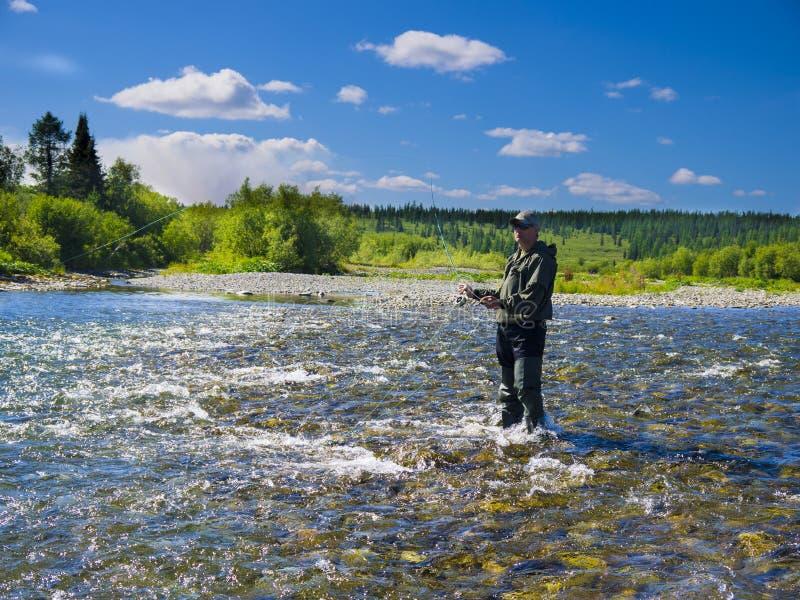河的一位渔夫 图库摄影