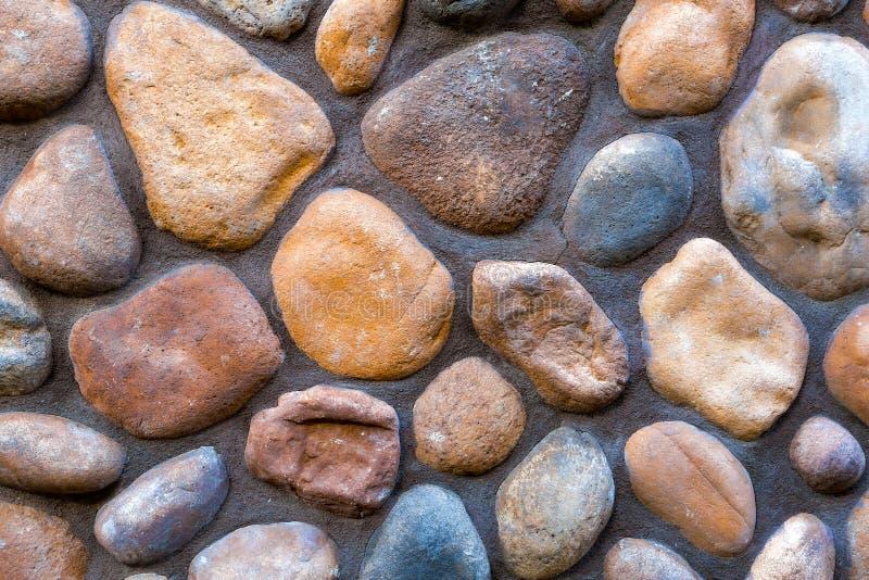 河石岩石墙壁背景特写镜头细节 图库摄影