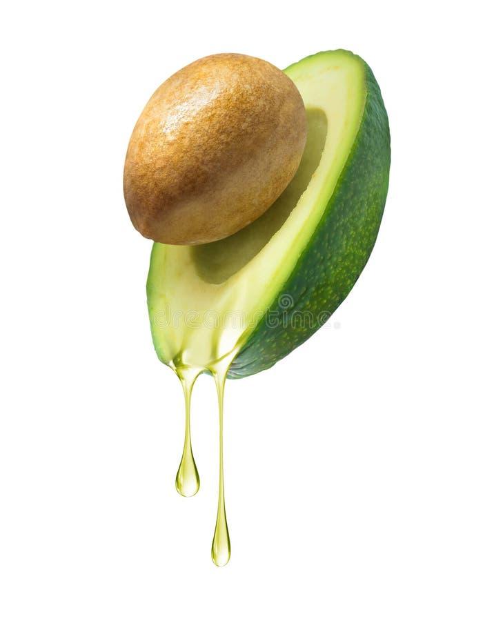 油水滴下落从鲕梨的在白色背景 库存照片