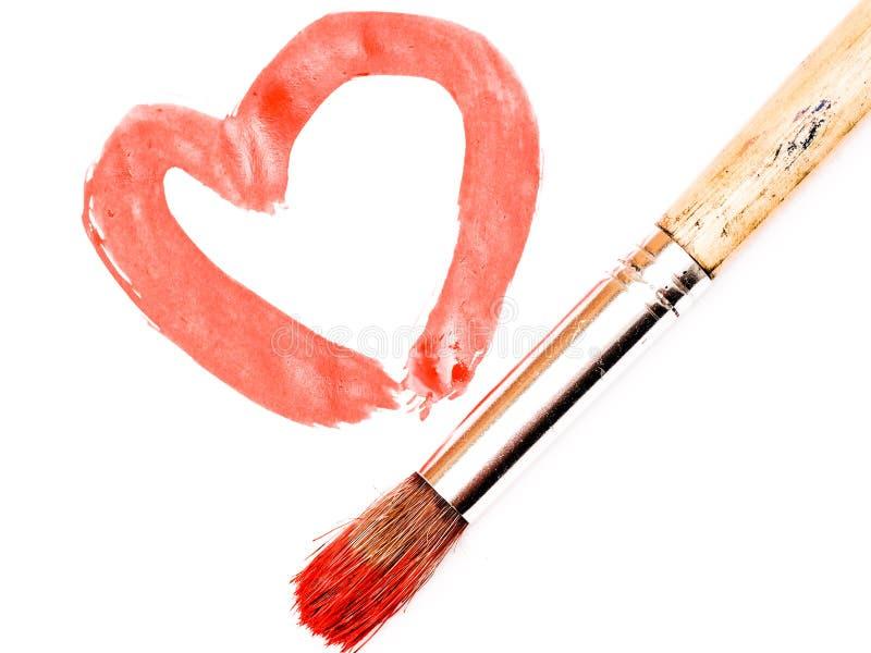 油漆刷和被绘的心脏 免版税图库摄影