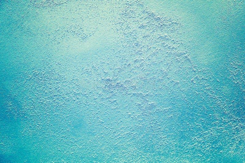 油漆威尼斯式明亮的蓝色绿松石海洋冰摘要纹理背景的污点 免版税图库摄影