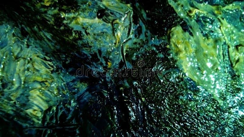 油漆污迹特写镜头帆布的表面上的 免版税图库摄影