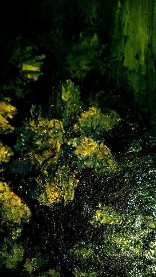 油漆污迹特写镜头帆布的表面上的 绿色,黄色,淡黄色的斑点 库存照片