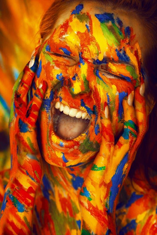 油漆的尖叫肉欲的妇女 免版税库存照片