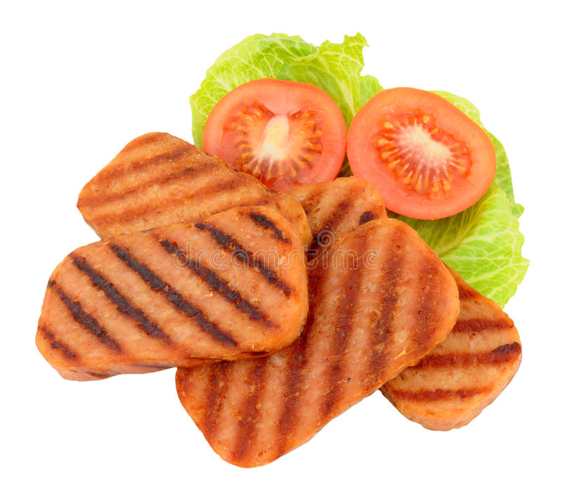 油煎的垃圾短信猪肉午餐肉和沙拉 库存图片
